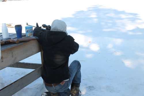 Shootin' up some coon.  uh, just kidding. Shootin' at each other.